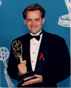 Adam accepting an Emmy